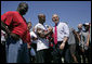President George W. Bush shakes hands with Tampa Bay Buccaneers' running back Michael Pittman during his visit to the NFL team's training facility in Tampa, Fla., Thursday, Sept. 21, 2006. White House photo by Paul Morse