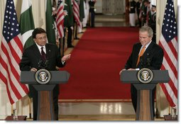 President George W. Bush listens as President Pervez Musharraf, of the Islamic Republic of Pakistan, responds to a question Friday, Sept. 22, 2006, during a joint press availability at the White House.  White House photo by Eric Draper