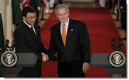 President George W. Bush and President Pervez Musharraf, of the Islamic Republic of Pakistan, shake hands after a joint press availability Friday, Sept. 22, 2006 in the East Room of the White House.  White House photo by Eric Draper