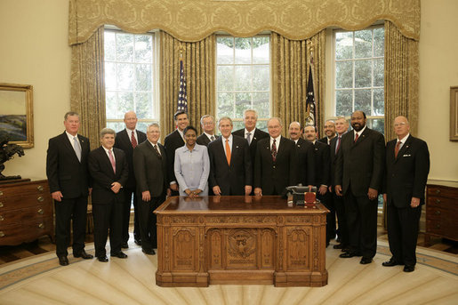 President George W. Bush meets with recipients of the Secretary of Defense Employer Support Freedom Award, Friday, Sept. 22, 2006 in the Oval Office. Presented annually, the award recognizes employers who provide outstanding support for their National Guard and Reserve employees. White House photo by Eric Draper