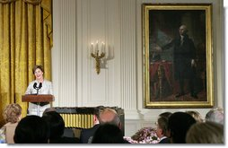 "Mrs. Laura Bush addresses guests during the announcement of the President's Global Cultural Initiative in the East Room Monday, Sept. 25, 2006. ""And one of the best ways we can deepen our friendships with the people of all countries is for us to better understand each other's cultures, by enjoying each other's literature, music, films and visual arts,"" said Mrs. Bush in her remarks.  White House photo by Shealah Craighead"