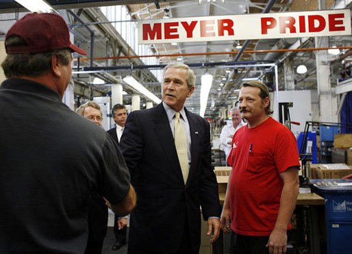 President George W. Bush meets employees of Meyer Tool Inc. Monday, Sept. 25, 2006 in Cincinnati, Ohio, while taking tour of the facility and stressed how important small businesses are to the nation's economic vitality. White House photo by Paul Morse