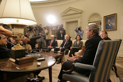 "President George W. Bush addresses the media during a meeting with business leaders on Lebanon Private Sector Initiative in the Oval Office Monday, Sept. 25, 2006. Seated next to President Bush is CEO John Chambers of Cisco Systems. Participants also include Chairman Craig Barrett of Intel Corp., CEO Ray Irani of Occidental Petroleum Corp., and Chairman Yousif Ghafari of Ghafari, Inc. ""Our goal, and our mission, is to help Lebanese citizens and Lebanese businesses not only recover, but to flourish, because we believe strongly in the concept of a democracy in Lebanon,"" said President Bush. White House photo by Eric Draper"