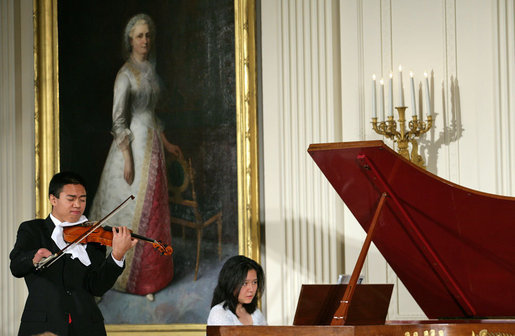 Violinist Adrian Anantawan and Amy Yang perform during the announcement of the President's Global Cultural Initiative in the East Room Monday, Sept. 25, 2006. White House photo by Shealah Craighead