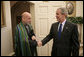 President George W. Bush welcomes President Hamid Karzai of Afghanistan to the Oval Office Tuesday, Sept. 26, 2006. White House photo by Eric Draper