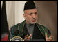 "President Hamid Karzai, of the Islamic Republic of Afghanistan, responds to a reporter's question Tuesday, Sept. 26, 2006, during a joint availability with President George W. Bush in the East Room of the White House. Said President Karzai, ""I think it is very important that we have more dedication and more intense work with sincerity, all of us, to get rid of the problems we have around the world."" White House photo by Paul Morse"