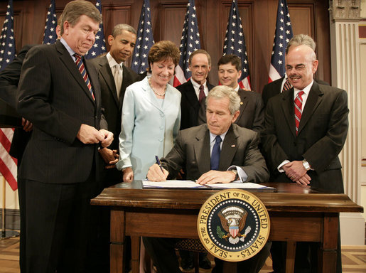 President George W. Bush signs into law S.2590, the Federal Funding Accountability and Transparency Act of 2006, Tuesday, Sept. 26, 2006, in the Dwight D. Eisenhower Executive Office Building. Looking on are Sen. Susan Collins, R-Maine, Chairwoman of the Homeland Security and Governmental Affairs Committee, and from left: Rep. Roy Blunt of Missouri, Sen. Barack Obama, D-Ill., Sen. Tom Carper, D-Del., Rep. Jeb Hensarling of Texas, and Rep. Henry Waxman of California. White House photo by Kimberlee Hewitt