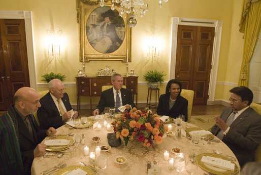 President George W. Bush sits with Vice President Dick Cheney and Secretary of State Condoleezza Rice as they host a working dinner Wednesday, Sept. 27, 2006, at the White House with President Hamid Karzai, left, of the Islamic Republic of Afghanistan, and President Pervez Musharraf, of the Islamic Republic of Pakistan. White House photo by Eric Draper