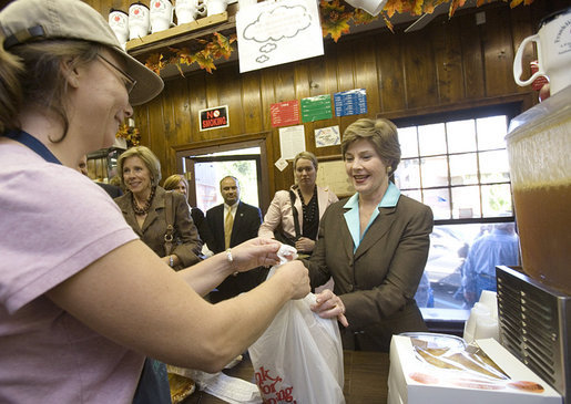 Mrs. Laura Bush makes a purchase at Franklin Cider Mill in Franklin, Mich., Thursday, Sept. 28, 2006. The mill dates back to 1837, the year Michigan was admitted to the Union. White House photo by Shealah Craighead