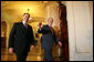 President George W. Bush and Senate Majority Leader Bill Frist, R-Tenn., walk past the press as they arrive for the Republican Senate Conference at the U. S. Capitol Thursday, Sept. 28, 2006. White House photo by Eric Draper