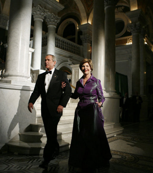 President George W. Bush and Laura Bush walk to the Great Hall of the Library of Congress in Washington, D.C., attending the 2006 National Book Festival Gala, an annual event of books and literature, Friday evening, Sept. 29, 2006. White House photo by Paul Morse