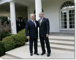 President George W. Bush walks with Kazakhstan President Nursultan Nazarbayev out to the Rose Garden at the White House, Friday, Sept. 29, 2006, following their meeting in the Oval Office.  White House photo by Eric Draper