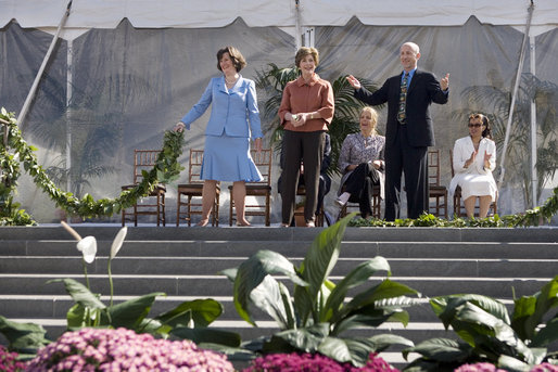 Mrs. Laura Bush joined by, left, Leone Reeder, Chair, National Fund for the U.S. Botanic Garden, and, right, Jim Hagedorn, Co-Chair, Board of Trustees, National Fund for the U.S. Botanic Garden, while the Ceremonial Garland is cut Friday, September 29, 2006, during a ceremony to celebrate the completion of the National Garden at the United States Botanic Garden in Washington, D.C. This new facility, located on a three-acre site just west of the Conservatory, will be a showcase for unusual, useful, and ornamental plants that grow well in the mid-Atlantic region. White House photo by Shealah Craighead