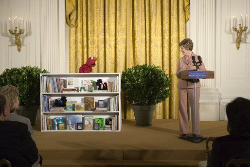 Mrs. Laura Bush talks with Elmo, a puppet on the children's television show Sesame Street, in the East Room of the White House, Saturday, September 30, 2006, during the seventh annual National Book Festival opening ceremony in Washington, D.C. The festival, held on the grounds of the National Mall, will include author readings, book signings, musical performances, and storytelling for children, adults and families. More than 80 noted authors and artists from around the country will participate. White House photo by Shealah Craighead
