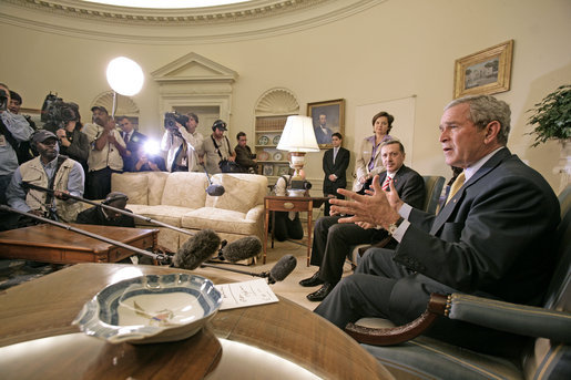 "President George W. Bush and Prime Minister Recep Tayyip Erdogan of Turkey talk to the press in the Oval Office Monday, October 2, 2006. ""We had an important discussion about both Iraq and Iran. Our desire is for -- to help people who care about a peaceful future to reject radicalism and extremism,"" said President Bush. White House photo by Eric Draper"