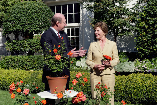 Mrs. Laura Bush smiles at Bill Williams, President and CEO of Harry & David Holdings, Monday, October 2, 2006, as she participates in a ceremony for the unveiling of the Laura Bush rose in The First Lady's Garden at The White House. Founded in 1872, Jackson & Perkins is a leading hybridizer of garden roses and has launched The Laura Bush rose as part of the First Ladies Rose Series. The rose is a floribunda rose and has light yellow buds that open to a smoky coral color with yellow on the reverse petal. White House photo by Shealah Craighead