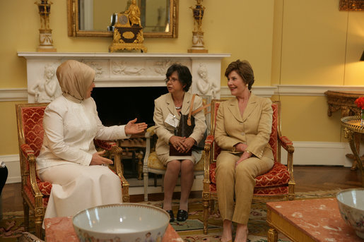 Mrs. Laura Bush visits with Mrs. Emine Erdogan, wife of Prime Minister Recep Tayyip Erdogan of Turkey , in the Yellow Oval Room in the private residence of the White House Monday, October 2, 2006. White House photo by Shealah Craighead