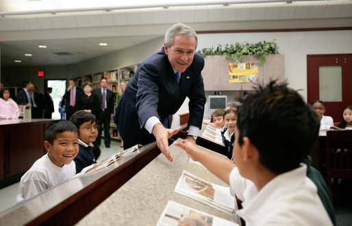 President George W. Bush greets students during a tour of the Laura Bush Library at George W. Bush Elementary School in Stockton, Calif., Tuesday, Oct. 3, 2006. White House photo by Eric Draper