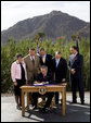 President George W. Bush is joined by Arizona legislators as he signs H.R. 5441, Department of Homeland Security Appropriations Act for fiscal year 2007, Wednesday, Oct. 4, 2006, against a backdrop of Camelback Mountain in Scottsdale. From left are: Arizona Gov. Janet Napolitano, Rep. J.D. Hayworth, Rep. Rick Renzi, Sen. Jon Kyl, R-Ariz., and Rep. Trent Franks. White House photo by Eric Draper