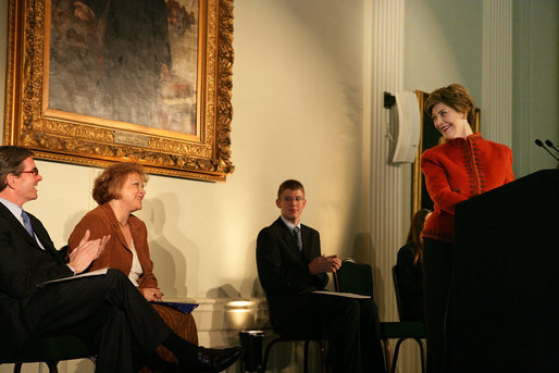 Mrs. Laura Bush smiles at Gerry Kohler, recipient of the 2006 Preserve America History Teacher of the Year award, while delivering remarks during a ceremony at the Union League Club in New York City, Thursday, October 5, 2006. Mrs. Kohler is a teacher at VanDevender Junior High School in West Virginia. Also shown are Dr. James Basker, President, Gilder Lehrman Institute of American History, left, and Patrick Shahan and Elizabeth Corbit, students of Mrs. Kohler's. White House photo by Shealah Craighead