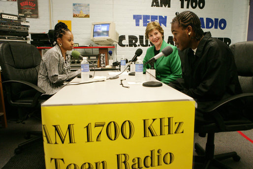 Mrs. Laura Bush participates in a radio interview with Amber Bellamy, age 17, left, and Elliott White, Jr., age 22, Wednesday, October 4, 2006, during a visit to the Children's Training Network/AM 1700 Radio Program in Buffalo, New York, as part of the President's Helping America's Youth initiative. Together with Crucial Human Service Center and other Buffalo community programs, AM 1700 Station encourages caring adults to connect as mentors with high-risk youth. White House photo by Shealah Craighead