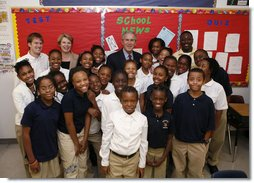 President George W. Bush and U.S. Secretary of Education Margaret Spellings pose for a photo with students during their visit Thursday, Oct. 5, 2006, to the Woodridge Elementary and Middle Campus in Washington, D.C.  White House photo by Paul Morse