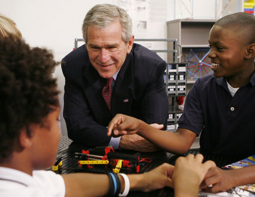 President George W. Bush talks with students during his visit Thursday, Oct. 5, 2006, in the SmartLab of the Woodridge Elementary and Middle Campus in Washington, D.C., where students demonstrated various math, science and technology projects. White House photo by Paul Morse