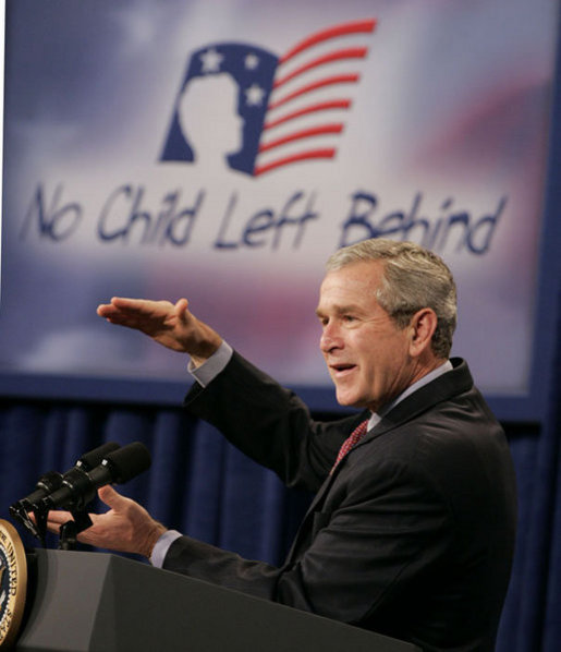 President George W. Bush gestures as he addresses his remarks Thursday, Oct. 5, 2006, at the Woodridge Elementary and Middle Campus in Washington, D.C., where President Bush praised the education advancements made through the No Child Left Behind law but also talked about ideas to strengthen the law in the future. White House photo by Paul Morse