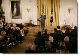 President George W. Bush welcomes invited guests Friday, Oct. 6, 2006 to the East Room of the White House, as part the festivities in celebration of National Hispanic Heritage Month. White House photo by Kimberlee Hewitt