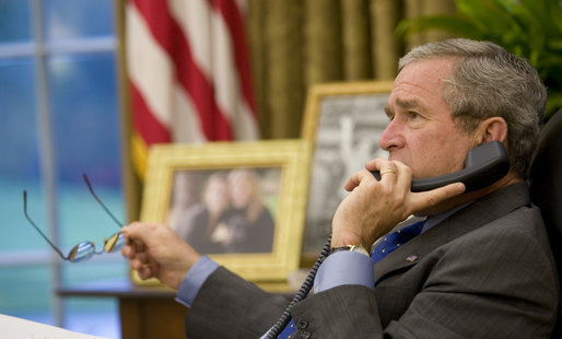 President George W. Bush speaks on the phone with Senegalese President Abdoulaye Wade in the Oval Office Friday, Oct. 6, 2006, about the current crisis in Darfur. White House photo by Eric Draper