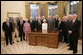 President George W. Bush meets with the members of the Supreme Headquarters Allied Expeditionary Force/Headquarters European Theater of Operations U.S. Army Veterans Association Friday, Oct. 6, 2006, in the Oval Office at White House. The group was organized in 1985 as a way to pay tribute to the memory of their supreme commander, Dwight D. Eisenhower, and their visit to the White House marks their 21st and final reunion gathering. White House photo by Paul Morse