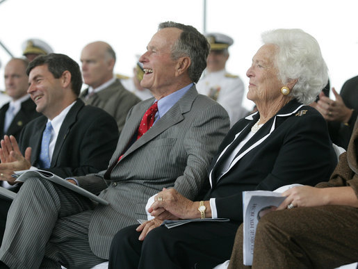 Former President George H. W. Bush and First Lady Barbara Bush react during remarks by President George W. Bush during the Christening Ceremony for the George H.W. Bush (CVN 77) in Newport News, Virginia, Saturday, Oct. 7, 2006. White House photo by Eric Draper