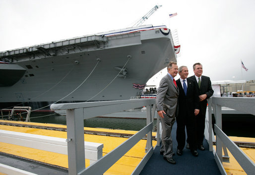 President George W. Bush, father President George H. W. Bush and brother Florida Governor Jeb Bush depart at the conclusion of the Christening Ceremony for the George H.W. Bush (CVN 77) in Newport News, Virginia, Saturday, Oct. 7, 2006. White House photo by Eric Draper
