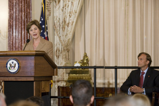 Newly sworn-in Ambassador Mark Dybul, Coordinator of the Office of the US Global AIDS, looks at Mrs. Laura Bush as she speaks to an audience of Ambassadors to the United States, government officials, representatives from the public health sector and Non-Governmental Organizations Tuesday, October 10, 2006, during the swearing-in ceremony of Ambassador Mark Dybul in the Benjamin Franklin Room at the U.S. Department of State in Washington, D.C. Ambassador Dybul will coordinate and oversee the U.S. global response to HIV/AIDS, and lead implementations of the U.S. President's Emergency Plan for AIDS Relief (Emergency Plan/PEPFAR), the largest commitment ever by any nation for an international health initiative dedicated to a single disease. White House photo by Shealah Craighead