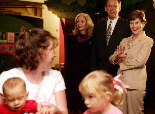 Mrs. Laura Bush waves to visitors during a tour of Cinergy Children's Museum in Cincinnati, Ohio, Wednesday, October 11, 2006. Ranked among the world's top 25 children museums, Cinergy Children's Museum offers more than 1,800 hours of programming for children in areas such as arts, culture, reading and science. White House photo by Shealah Craighead