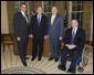 President George W. Bush welcomes Bob Wallace, left, the executive director of the Veterans of Foreign Wars Washington Office; Gary Kurpius, the National Commander-In-Chief of the Veterans of Foreign Wars and Gordon Mansfield, right, the deputy secretary at the Department of Veterans Affairs, to the Oval Office for a meeting Wednesday, Oct. 11, 2006. The VFW, founded in 1899, is the largest organization of combat veterans with some 2.4 million members in 9,500 VFW Posts worldwide. White House photo by Paul Morse