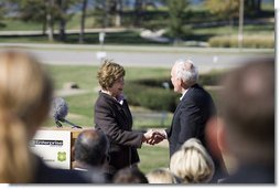 Mrs. Laura Bush shakes hands with Andy Taylor, chairman and CEO of Enterprise Rent-A-Car, following her remarks Thursday, October 11, 2006, during a tree planting ceremony for the Enterprise 50 Million Tree Pledge in St. Louis, Missouri. White House photo by Shealah Craighead