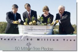 Mrs. Laura Bush is joined by, from left, U.S. Department of Agriculture Secretary Mike Johanns; John Rosenow, president of the National Arbor Day Foundation, and Andy Taylor, chairman and CEO of Enterprise Rent-A-Car, as they plant White Pine saplings Thursday, October 11, 2006, during a ceremony for the Enterprise 50 Million Tree Pledge in St. Louis, Missouri. Enterprise Rent-A-Car donated $50 million to the National Arbor Day Foundation to plant 50 million trees in National Forests over the next 50 years. The White Pine saplings planted at the ceremony will be re-planted permanently in the Mark Twain National Forest in southern Missouri.  White House photo by Shealah Craighead