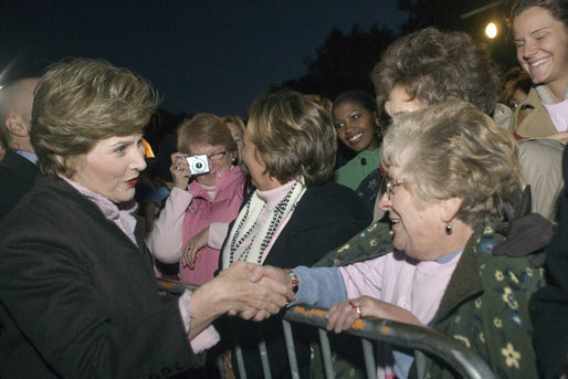 Mrs. Laura Bush greets members of the audience members that include representatives from breast cancer organizations, supporters of breast cancer research, breast cancer survivors and local residents during the Arch Lighting for Breast Cancer Awareness Thursday, Oct. 12, 2006, in St. Louis. White House photo by Shealah Craighead