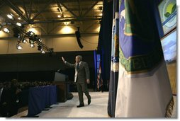 President George W. Bush waves as he leaves the stage following his keynote address at the 2006 Advancing Renewable Energy: An American Rural Renaissance Conference, Thursday, Oct. 12, 2006, at the St. Louis Convention Center in St. Louis, Mo. President Bush discussed the development of new energy sources that reduce America's consumption of oil, such as hydrogen, ethanol and biodiesel. White House photo by Eric Draper