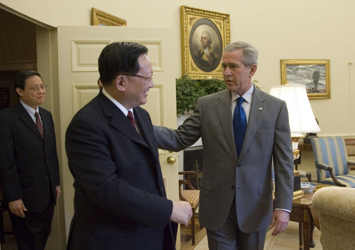 President George W. Bush meets with The State Councilor of China, Tang Jiaxuan, in the Oval Office Thursday, Oct. 12, 2006. White House photo by Kimberlee Hewitt