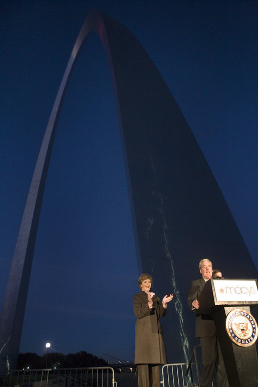 Mrs. Laura Bush applauds Chairman and CEO William McNamara of Macy's Midwest, as he delivers welcoming remarks during the Arch Lighting for Breast Cancer Awareness event in Thursday, Oct. 12, 2006, in St. Louis. The Gateway Arch was illuminated in pink in honor of Breast Cancer Awareness Month. White House photo by Shealah Craighead