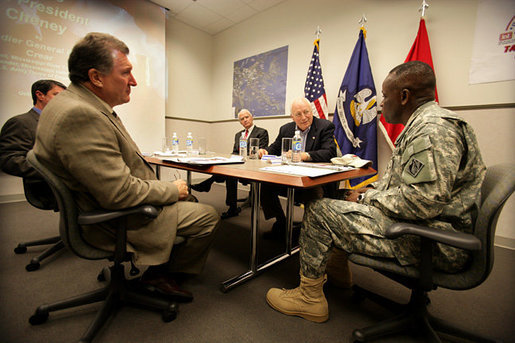 Vice President Dick Cheney speaks with Brigadier General Robert Crear, Commander of the Mississippi Valley Division of the U.S. Army Corps of Engineers, during a briefing on Hurricane Katrina recovery held at the New Orleans Port Authority in New Orleans, La., Thursday, October 12, 2006. The U.S. Army Corps of Engineers has been working to address flood problems along the Mississippi River since the 1800's and is responsible for rebuilding the 169 miles of levees in the southeast Louisiana area that sustained damage as a result of Katrina. White House photo by David Bohrer