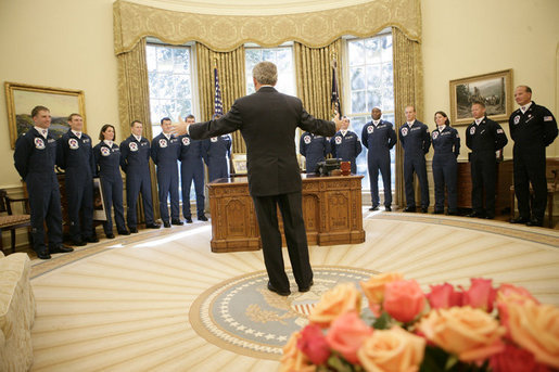 President George W. Bush gestures as he speaks to the U.S. Air Force Thunderbirds during their visit to the Oval Office, Friday, Oct. 13, 2006. The Thunderbirds are scheduled to perform a fly over for the opening of the Air Force Memorial in Arlington, Va., Saturday, Oct. 14, 2006. White House photo by Eric Draper