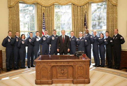 President George W. Bush welcomes members of the U.S. Air Force Thunderbirds to the Oval Office, Friday, Oct. 13, 2006. The Thunderbirds are scheduled to perform a fly over for the opening of the Air Force Memorial in Arlington, Va., Saturday, Oct. 14, 2006. White House photo by Eric Draper