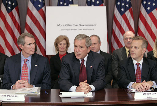 President George W. Bush addresses members of the President's Management Council, Friday, Oct. 13, 2006, in a meeting at the Eisenhower Executive Office Building in Washington, D.C. Pictured with the President are OMB Director Rob Portman, left, and Labor Deputy Secretary Steven Law. The council met to discuss the President's Management Agenda accomplishments, which will be summarized in a government-wide report to Federal employees and Congress on the state of the government's management practices. White House photo by Eric Draper