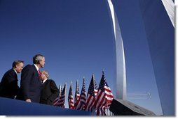 President George W. Bush observes the Air Force Thunderbirds performing at the dedication of the United States Air Force Memorial in Arlington, Virginia on October 14, 2006. White House photo by Paul Morse