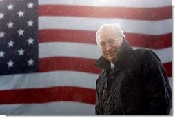 Vice President Dick Cheney stands in a steady rain during a rally at Fort Campbell Army Base in Fort Campbell, Ky., Monday, October 16, 2006. The Vice President visited Fort Campbell to welcome home over 4,000 troops from the 101st Airborne Division who returned in September from a tour of duty in Iraq. White House photo by David Bohrer