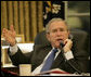 President George W. Bush gestures as he speaks with Iraq's Prime Minister Nouri al-Maliki during a telephone conversation Monday, Oct. 16, 2006, in the Oval Office. White House photo by Eric Draper