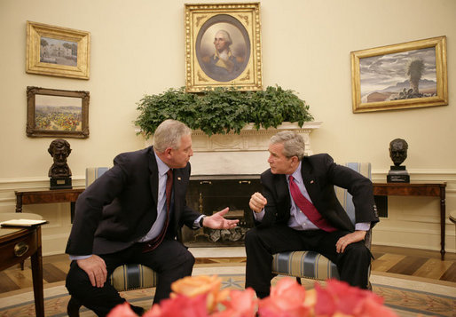 President George W. Bush and the Prime Minister of the Republic of Croatia H.E. Ivo Sanader talk together in the Oval Office at the White House, Tuesday, Oct. 17, 2006. White House photo by Eric Draper